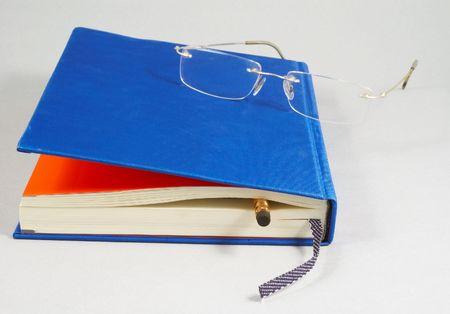 eyeglass on book Stock Photo - 406825
