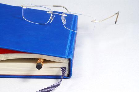 eyeglass on book Stock Photo - 406826