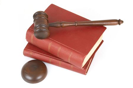 adjourned: gavel and old rusty books on white background Stock Photo
