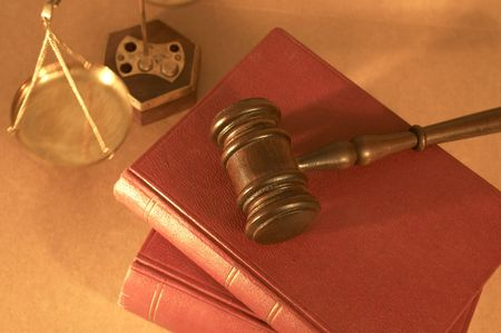 adjourned: gavel close up on old books, shallow dof