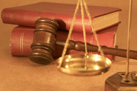 adjourned: gavel and old rusty books, shallow dof Stock Photo