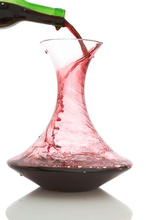 carafe: red wine into the carafe on white background