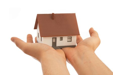 mini house on hands, white background
