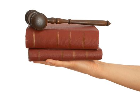 adjourned: gavel and old law book on white background