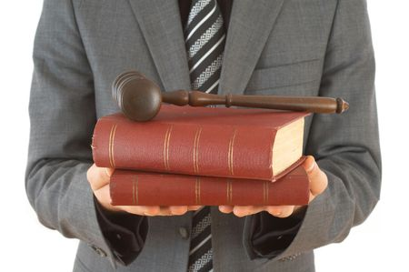 adjournment: businessman holding gavel and law books, on white