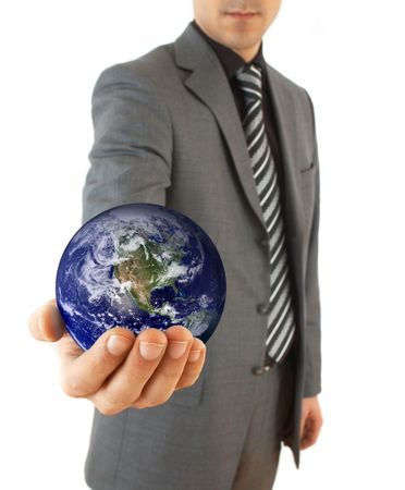 online internet presence: young businessman holding globe, on white background, map used from nasa.gov, their copyright statement http:www.visibleearth.nasa.govuseterms.php