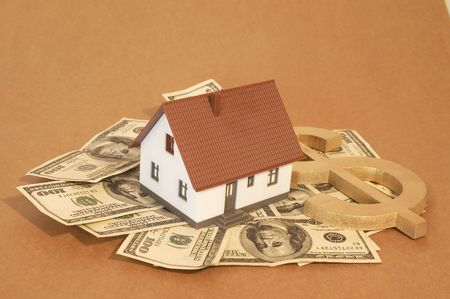 real estate concept with mini house, Us dollars and dollar sign, space for messages Stock Photo - 892909