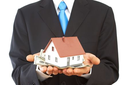 real estate concept, businessman close up, holding US dollars and house Stock Photo - 892992