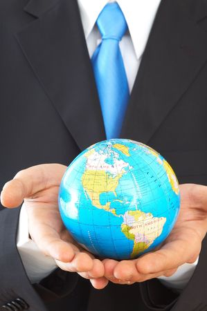 online internet presence: businessman close up, holding mini globe, shallow dof Stock Photo