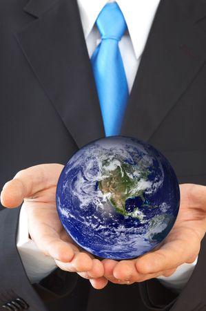 online internet presence: businessman holding globe, shallow dof
