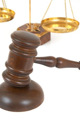 judicial proceeding: gavel close up on white background with shallow dof Stock Photo