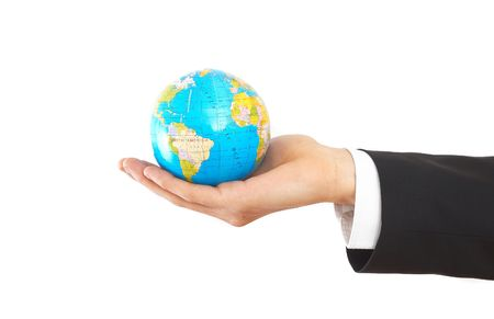 online internet presence: businessman hand on white with a globe