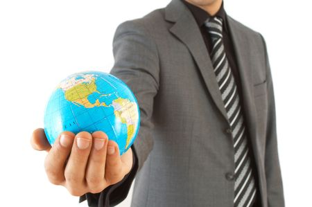 online internet presence: businessman holding mini globe, shallow dof