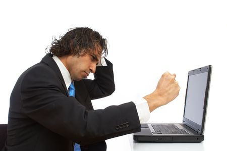 highend: young businessman angry and hitting laptop