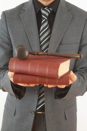 adjourned: businessman holding old law books and gavel