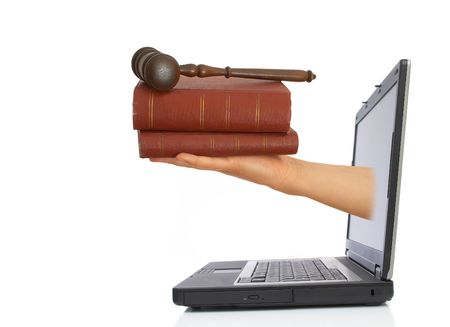 book and gavel coming from laptop with space for messages on the left photo