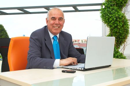 telework: businessman with a smile in front of the laptop Stock Photo
