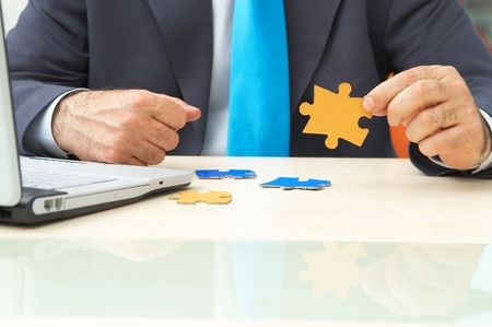 businessman with colorful puzzle pieces and laptop Stock Photo - 968720