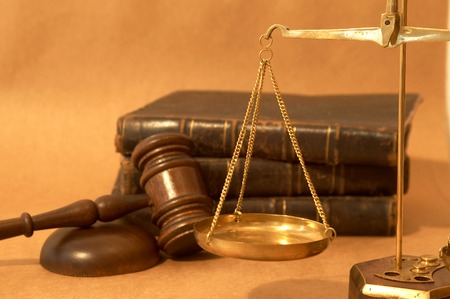 adjourned: legal concept with gavel, books and scales of justice Stock Photo