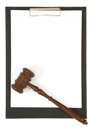 adjourned: gavel and clipboard with space for messages Stock Photo