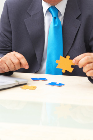 business solution concept with businessman and colorful puzzles  Stock Photo - 1583216