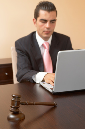 legal concept with a gavel and businessman  photo