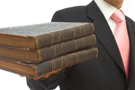 businessman holding old books on white background Stock Photo - 1678034