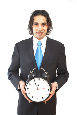 business concept with businessman holding an alarm clock photo