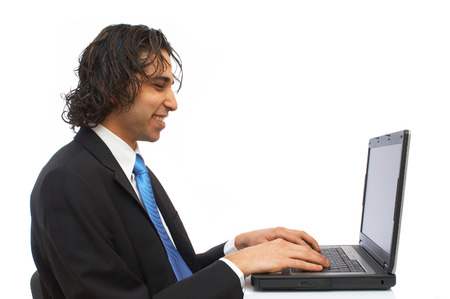 young businessman working on laptop photo