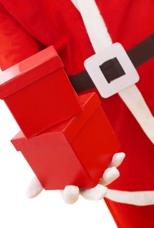 santa giving 2 red christmas presents, shallow dof photo