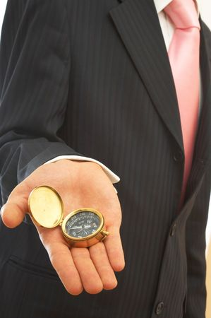businessman holding an old compass on white Stock Photo - 1810155