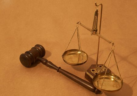 judicial proceeding: legal concept with gavel and balance of scales
