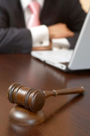 law concept with a gavel and laptop at the office photo