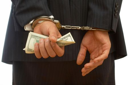 injustice: business crime concept with handcuffs and dollar