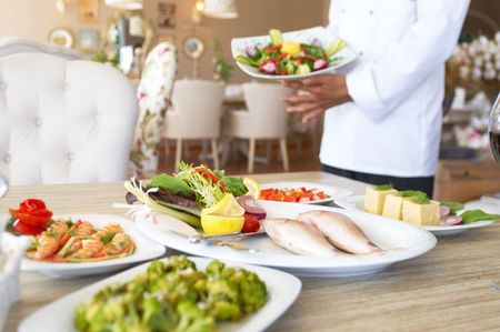 lux: lux restaurant with lots different food, shallow dof Stock Photo