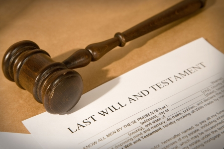 testament: last will and testament form with gavel, shallow dof