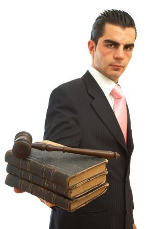 business law concept with businessman holding gavel and books photo