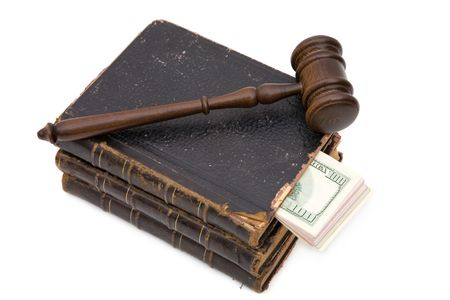 adjourned: legal concept with gavel, law book and Us dollar on white, shallow dof