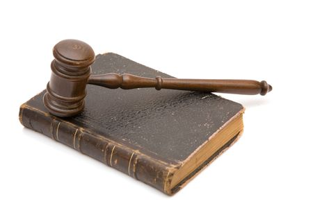 judicial: legal concept with wood gavel and old law book, shallow dof