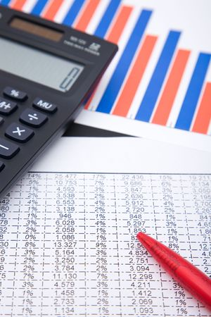 office desk with a calculator and business charts, shallow dof Stock Photo - 2160906
