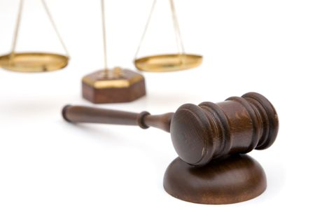 adjourned: legal concept with a gavel and scales of justice