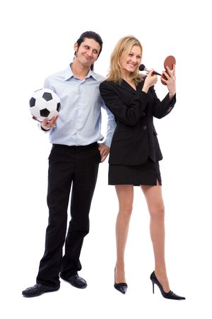kickball: businesswoman with make up set and her husband with soccer ball Stock Photo