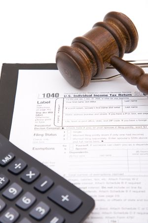 autograph: business tax form close up with gavel and calculator