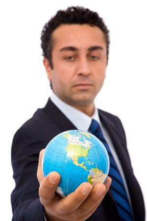senior businessman holding a mini globe, shallow dof Stock Photo - 2464157