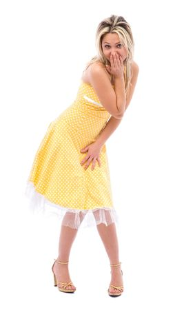 beautiful surprised girl with a yellow dress on white background Stock Photo - 2476022