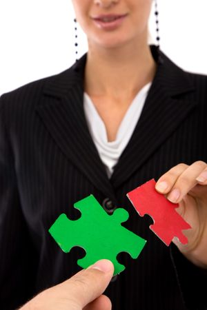 teamwork concept with colorful puzzle pieces and business people Stock Photo - 2482235