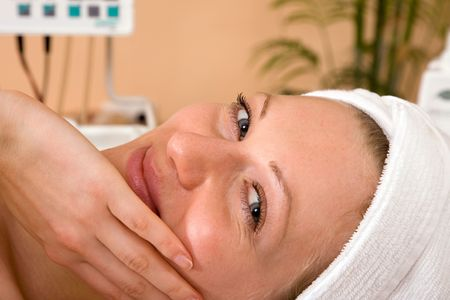 soothe: beautiful young woman happy at the spa center Stock Photo