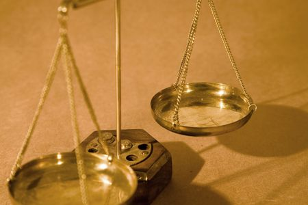 Scales of justice close up on paper background, shallow dof Stock Photo - 2514749