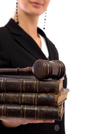 adjournment: businesswoman holding old book and gavel for legal concept