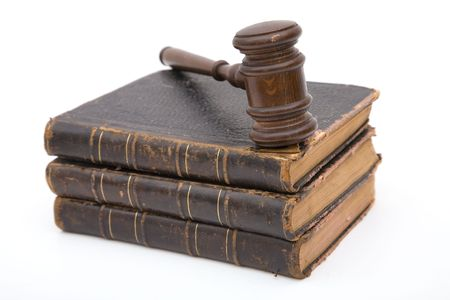 adjourned: legal concept with old gavel and books on white background Stock Photo